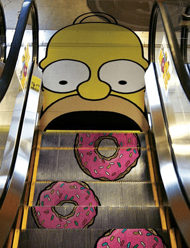 Simpson is shown enjoying his donuts